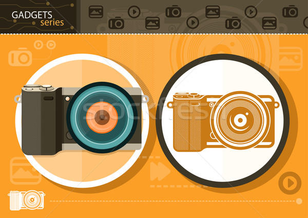 Digital camera in frame on orange background Stock photo © robuart
