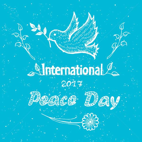Internacional paz día anunciante paloma vuelo Foto stock © robuart
