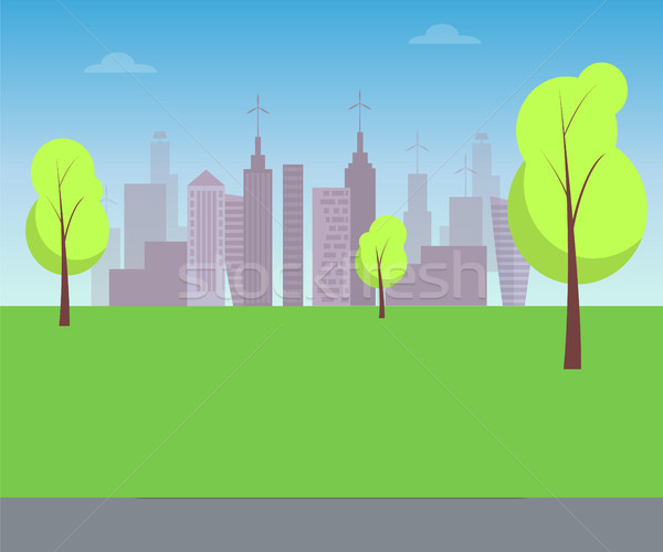 Green Lawn with Trees and Silhouettes of Buildings Stock photo © robuart