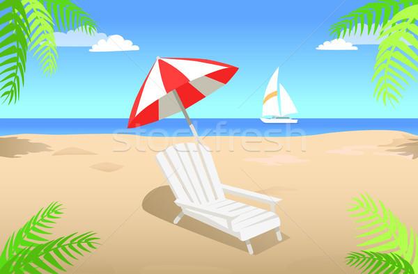 Tumbona paraguas playa de arena verano blanco a rayas Foto stock © robuart