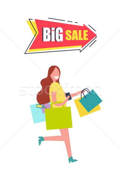 Nagy vásár nyíl nő hordoz szatyrok Stock fotó © robuart