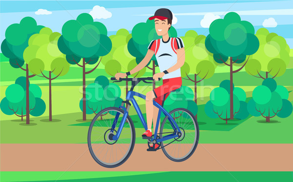 Gülen bisikletçi mavi bisiklet örnek adam Stok fotoğraf © robuart