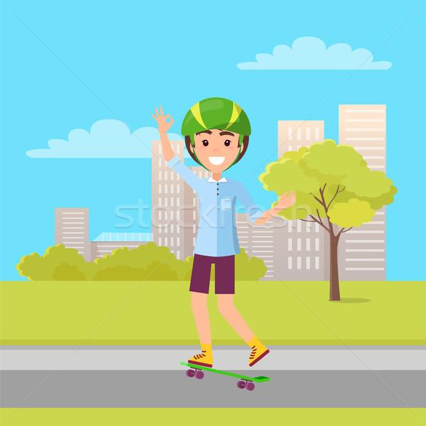 Stock photo: Happy Skateboarder Showing Ok Sign Skateboarding