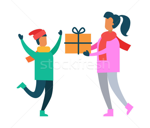 Mother Greets Son with Present Packed in Gift Box Stock photo © robuart