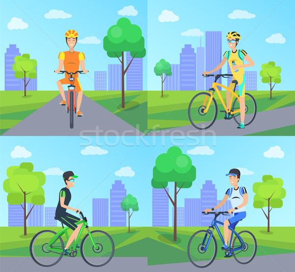 Biciklisták mosoly lovaglás út városkép felhőkarcolók Stock fotó © robuart