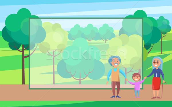 Szczęśliwy dziadkowie dzień starszy para wnuk spaceru Zdjęcia stock © robuart