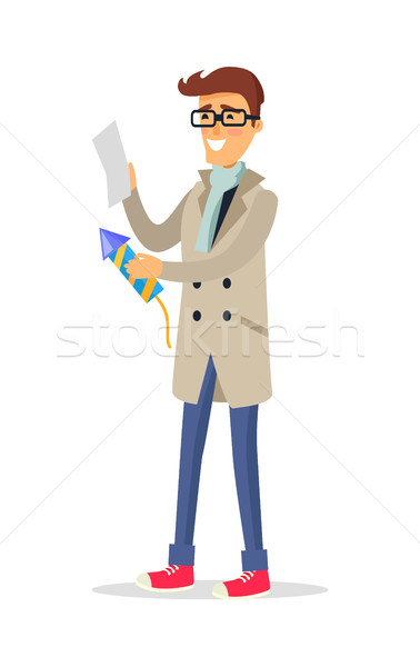 Isolated man in Beige Coat Blue Jeans Holds Rocket Stock photo © robuart