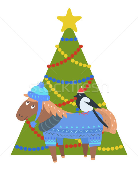 Donkey in warm winter cloth, bullfinch in santa s hat Stock photo © robuart