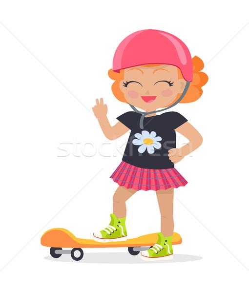 Menina rosa capacete saia laranja andar de skate Foto stock © robuart