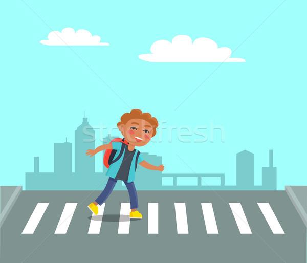 Smiling Boy at Crosswalk on Urban City Background. Stock photo © robuart