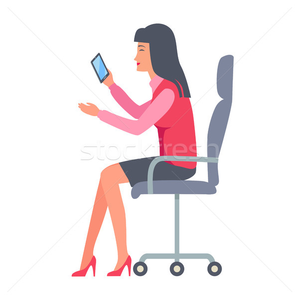 Businesswoman Sitting and Holding Mobile Phone Stock photo © robuart
