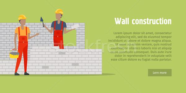 Mur construction deux hommes mur de briques casque rouge Photo stock © robuart