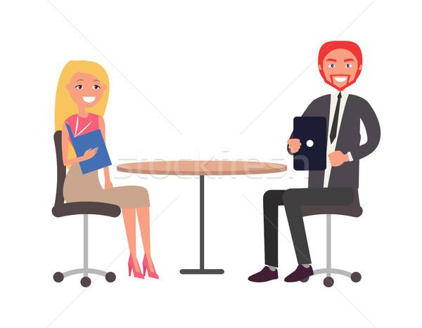 Człowiek kobieta formalny tkaniny posiedzenia tabeli Zdjęcia stock © robuart