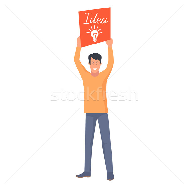 Smiling Male Holding Orange Card with New Idea Stock photo © robuart