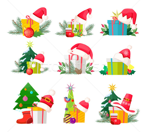 Stock photo: Set of Gift Boxes with Santa Claus Caps on White