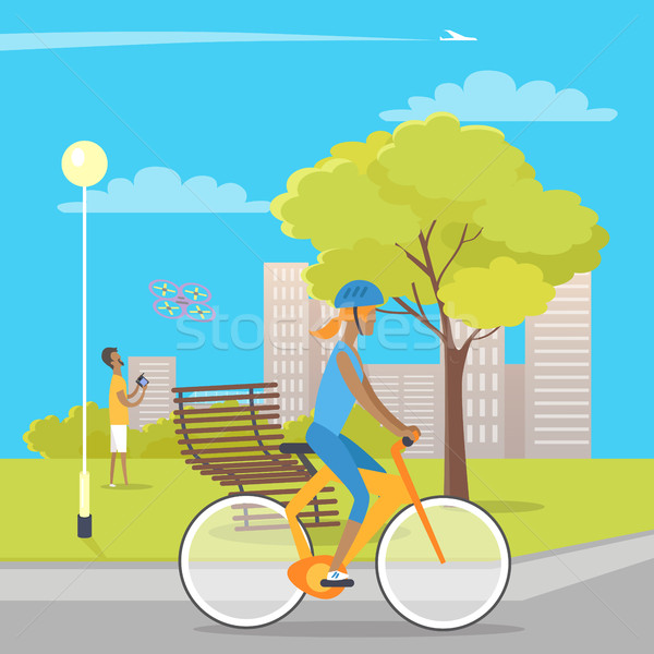 Girl on Bicycle and Boy Playing with Quadrocopter Stock photo © robuart