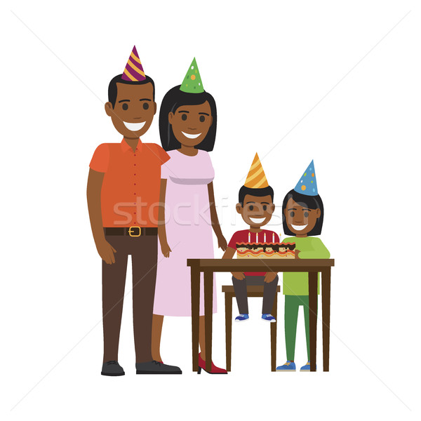 Family Yogrther at Table with Happy Birthday Cake Stock photo © robuart