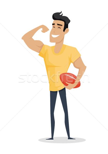 молодые красивый мужчина шоу бицепс руки мяча Сток-фото © robuart