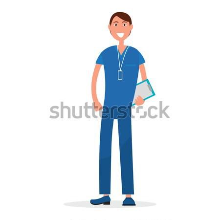 Uomo medico blu uniforme prescrizione elenco Foto d'archivio © robuart
