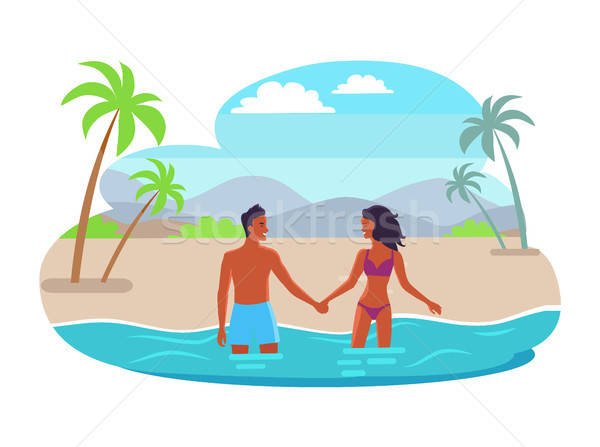 Suntanned Couples Hold Hands and Stand in Sea Stock photo © robuart