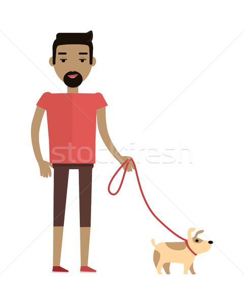 Young Man Walking His Dog Stock photo © robuart