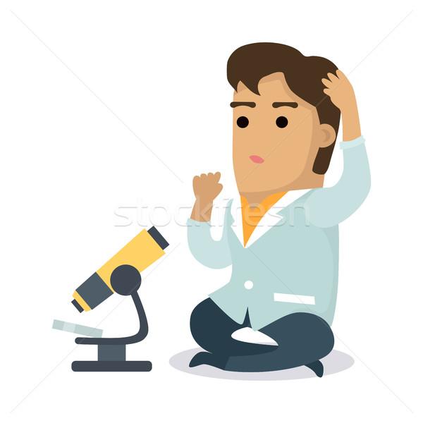 Bilim adamı mikroskop adam beyaz kat oturma Stok fotoğraf © robuart