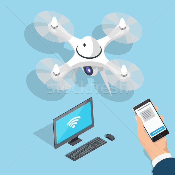 Flying Quadcopter, Computer, Man Hand with Phone Stock photo © robuart