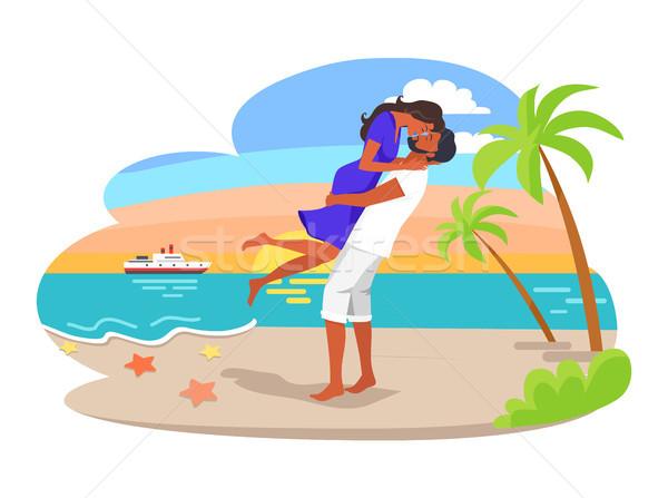 Pár ölelkezés vízpart férfi nő csók Stock fotó © robuart