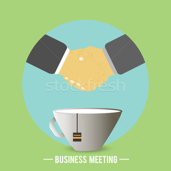 Handshake behind a cup of tea, coffee Stock photo © robuart