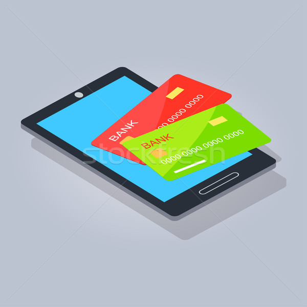 Two Payment Card Lying on Mobilephone or Tablet Stock photo © robuart