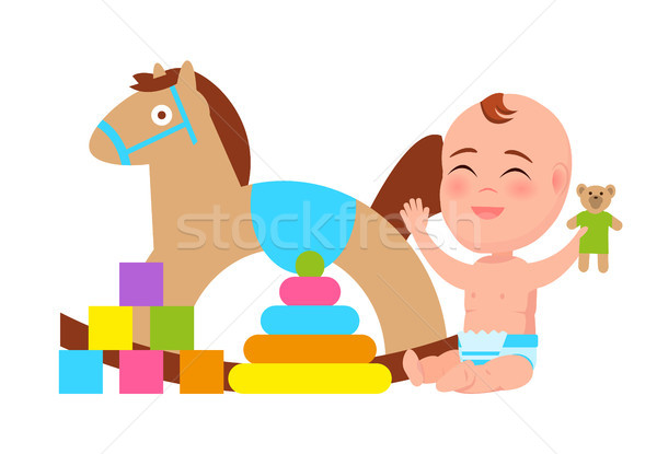 Happy Baby Play with Rocking Horse, Color Blocks Stock photo © robuart