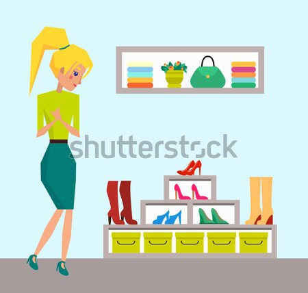 Woman near Big Shoes Rack from Modern Boutique Stock photo © robuart