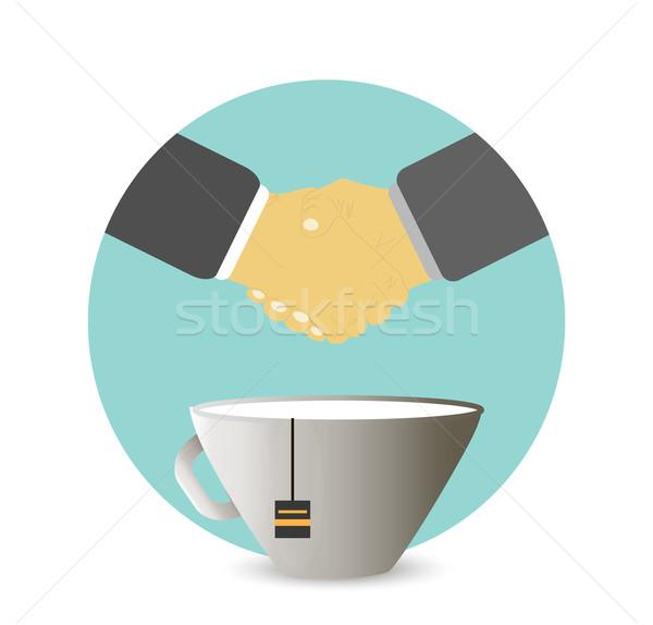 Handshake behind a cup of tea, coffee Stock photo © robuart