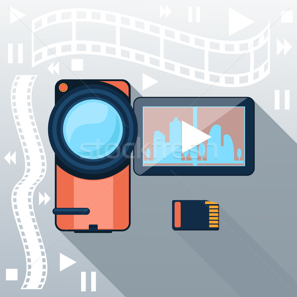 Video camera with cinema tape on background Stock photo © robuart