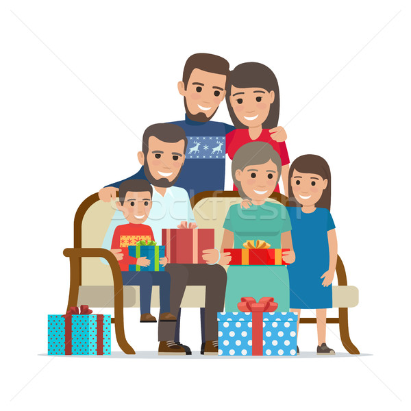 Family Gathered Together Holding Present Boxes Stock photo © robuart