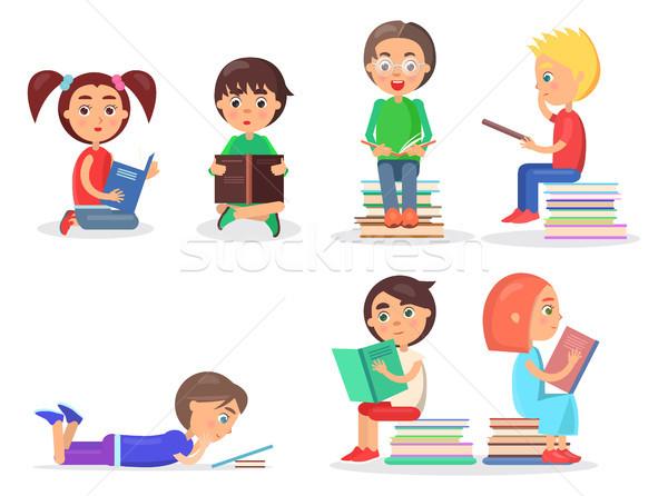 Lányok fiúk ül tankönyvek kicsi padló Stock fotó © robuart