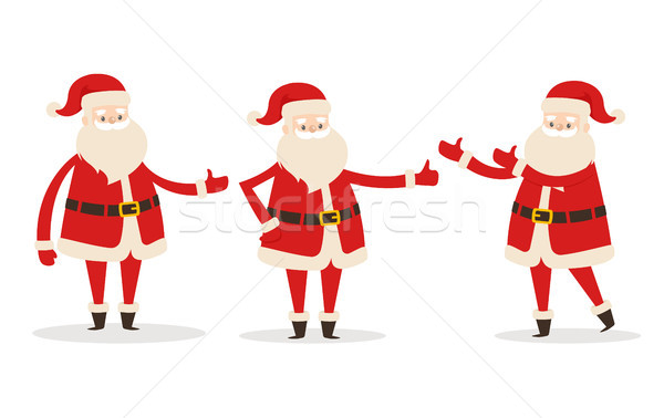 Set of Isolated Santa Clauses Showing Way. Statue Stock photo © robuart
