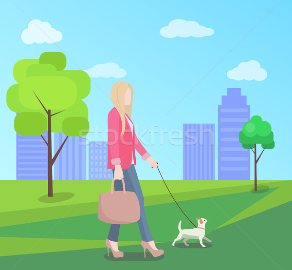 Stylish Young Woman Walking in Park with Small Dog Stock photo © robuart