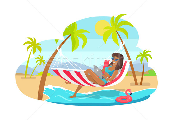 Freelancer Works on Laptop in Hammock at Beach Stock photo © robuart