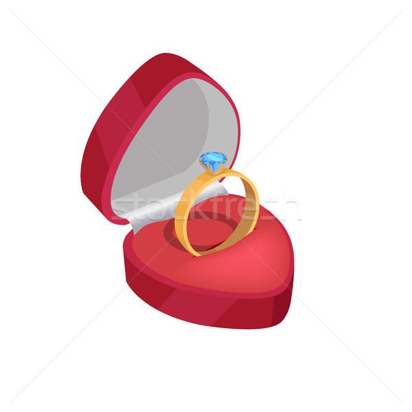 Złota pierścionek zaręczynowy niebieski diament czerwony polu Zdjęcia stock © robuart