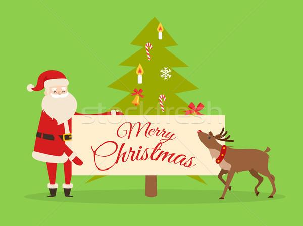 Christmas Banner in Santas Hand. New Year Fir Tree Stock photo © robuart
