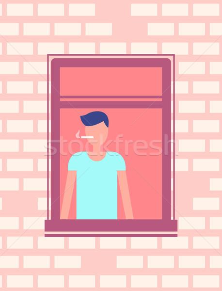 Man Smoking Cigarette near Open Window, Brick Wall Stock photo © robuart