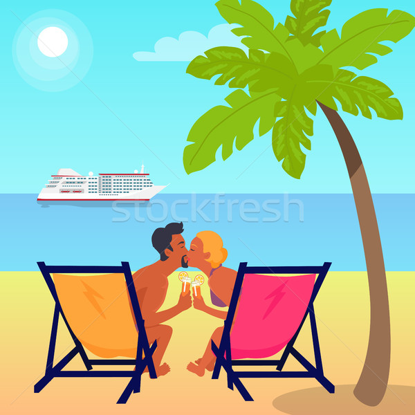 Couple on Recliners at Beach and Liner in Sea Stock photo © robuart