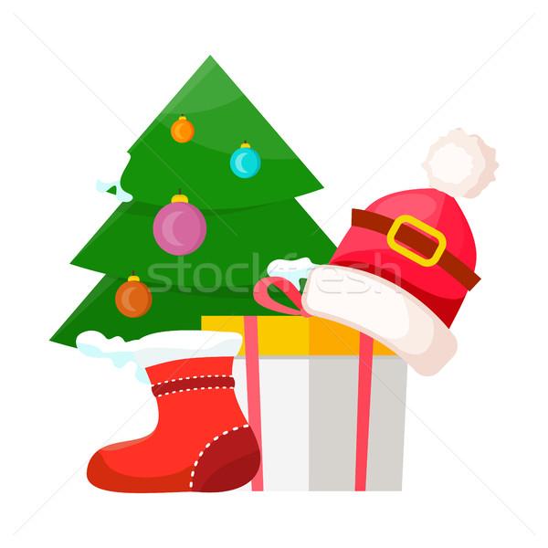 Christmas Tree near Present Box and Santa Cap Stock photo © robuart