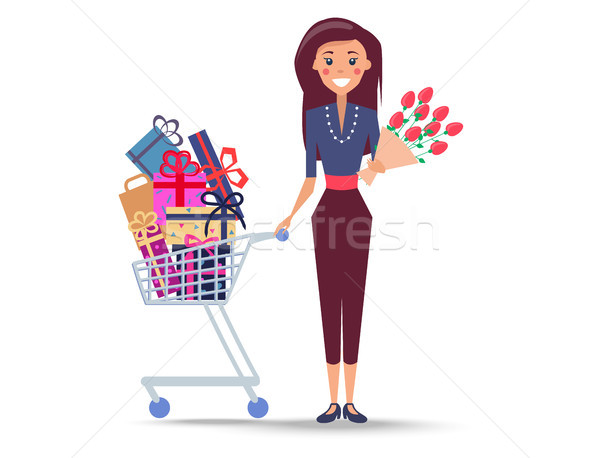 Cheerful Woman with Shopping Trolley Full of Gifts Stock photo © robuart