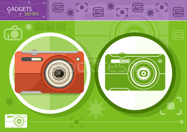 Digital camera in frame on green background Stock photo © robuart