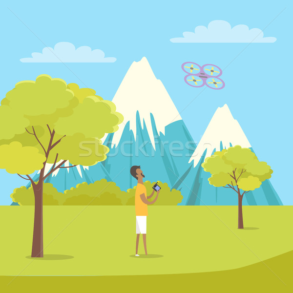 Boy Playing with Quadrocopter near Mountains. Stock photo © robuart