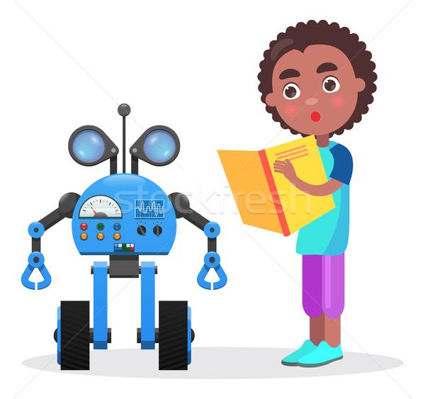 Stockfoto: Verwonderd · afrikaanse · jongen · boek · robot