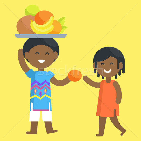 African Boy Holds Tray and Give orange to Girl Stock photo © robuart