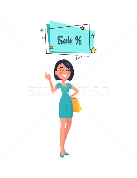 Mulher pensando de vendas azul vestido balão de fala Foto stock © robuart